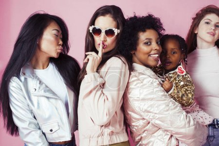 Photo for Three different nation girls with diversuty in skin, hair. Asian, scandinavian, african american cheerful emotional posing on pink background, woman day celebration, lifestyle people concept close up - Royalty Free Image