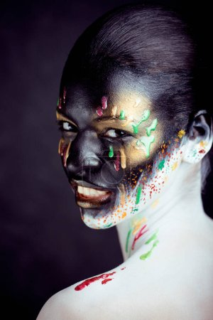 Photo for Woman with creative makeup closeup like drops of colors, facepaint splashes close up halloween - Royalty Free Image
