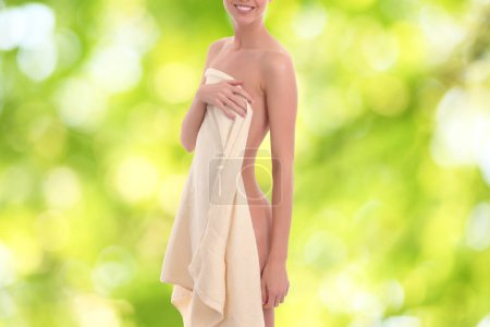 beautiful young woman body in white towel