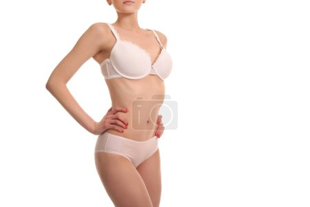 young woman with a slim figure in white lingerie