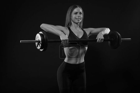 Photo for Sport woman lifting weight on black background - Royalty Free Image