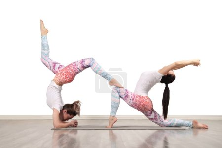 Photo for Young female acrobats make beautiful acrobatic poses - Royalty Free Image