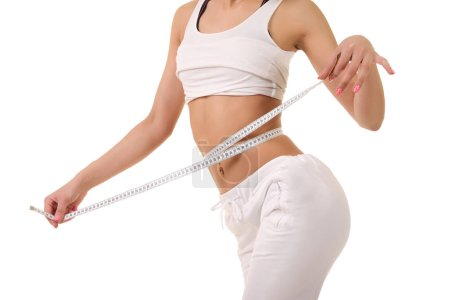 young girl with a thin waist makes measuring tape