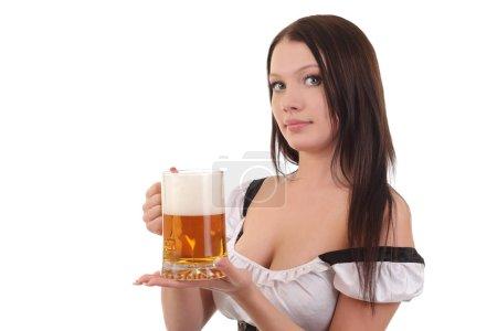 Woman in bavarian dress holding mug of beer