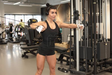 Photo for Fitness woman model performing weight lifting exercise at gym - Royalty Free Image