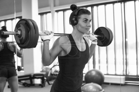 Photo for Fitness young sexy girl in the gym doing exercises - Royalty Free Image