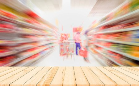 Foto de Blurred background of supermarket and wooden planks on foreground, motion blur - Imagen libre de derechos