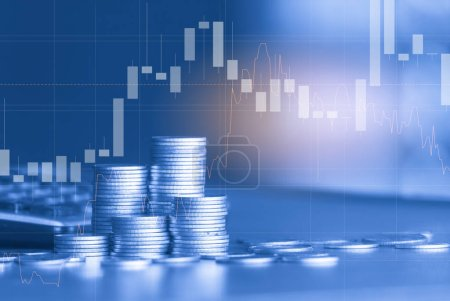 Photo for Stacks of golden coins with trading graph on background , financial investment concept - Royalty Free Image