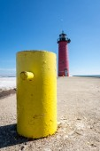 Kenosha north pierhead (pier head)  lighthouse with yellow boat mooring in late winter/early spring.