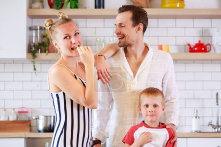 Photo for Photo of young couple with daughter in kitchen at apartment - Royalty Free Image