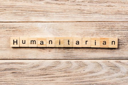 Humanitarian word written on wood block. humanitar...