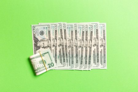 Top view of lying 20 dollar banknotes in one line on colorful background. Close up of money saving concept