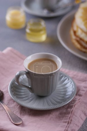 Photo for Breakfast with pancakes on a textured background - Royalty Free Image