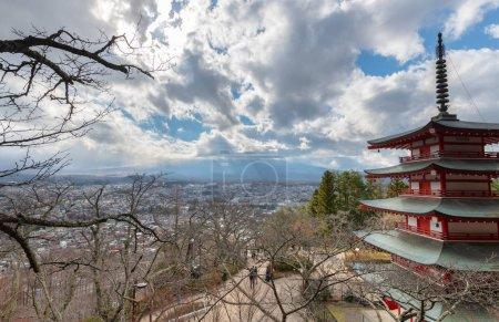 Chureito Pagoda and Mt. Fuji in autumn and cloudy blue sky, Fujiyoshida, Japan