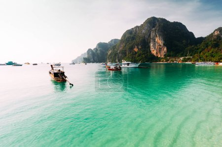 Photo for Laguna on the beautiful Thai Islands. Asian Islands. Thai Phi Phi Islands. Thai wooden boats. Boats in the Bay. Excursion to the Islands. Travel to Asia. Travel to Thailand. Lagoon on the island - Royalty Free Image