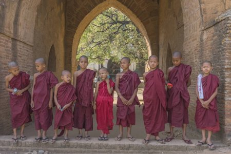 Photo for Kids buddhist monks  in temple of angkor wat, cambodia - Royalty Free Image