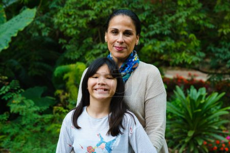 Photo for Mother with pre teenage daughter outdoor portrait. - Royalty Free Image