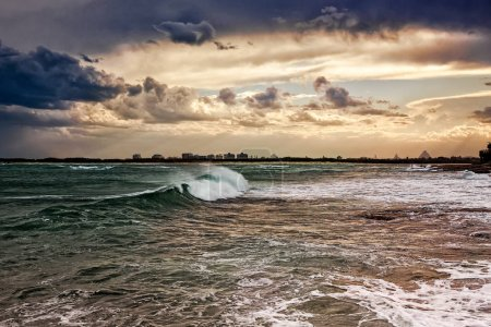 A big wave coming to shore on a beautiful autumn evening in Caloundra, Queensland, Australia.