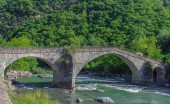 The medieval  bridge of Echallod in Arnad,  over the river  dora baltea in Aosta Valley//Italy.It is  a path of the famous way francigena