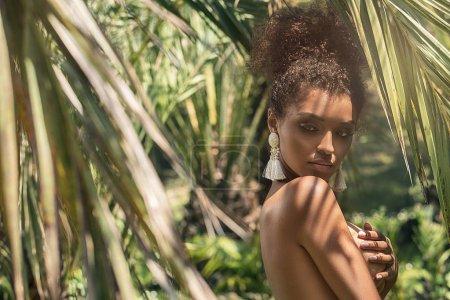 Tropical shoot of beautiful african american woman...
