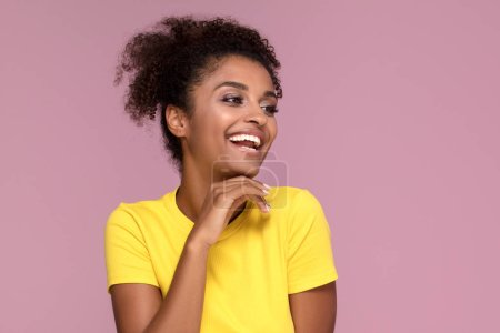 Photo for Excited african american woman smiling, posing on pink pastel background. - Royalty Free Image