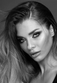 Beauty and femininity concept. Attractive woman in glamour makeup. Portrait photo.