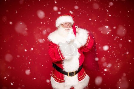Photo for Santa Claus , the real one, posing on red studio background , looking at camera. Christmas time. - Royalty Free Image