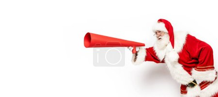 Photo for Photo of real Santa Claus running with red megaphone in hand isolated on white studio background. Christmas time. - Royalty Free Image