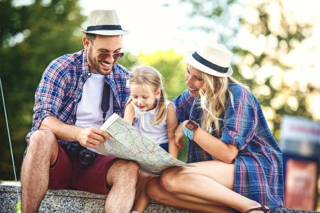 Young and happy family is enjoying traveling.