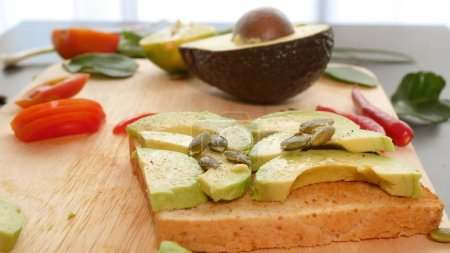 Photo for Avocado. concept of healthy eating and healthy lifestyle. cooking avocado sandwiches - Royalty Free Image