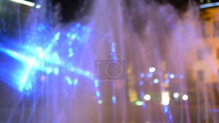 blurred background. fountain illuminated night illumination