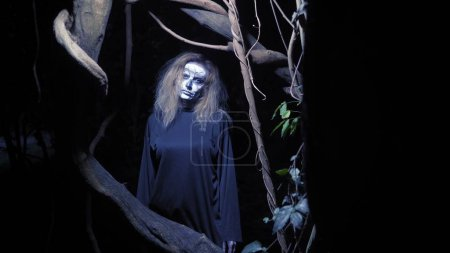 Photo for Concept of horror, ghost woman in the forest. Beautiful woman with make-up skeleton in a scary forest - Royalty Free Image