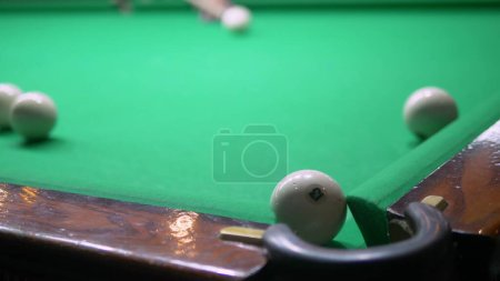 Billiards. Close-up. man hand with cue and white b...