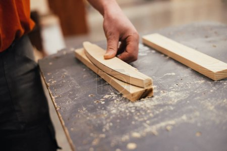 Photo for Cropped image of carpenter working with timber at workshop - Royalty Free Image
