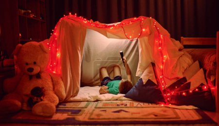 Photo for Little  boy playing in tent - Royalty Free Image