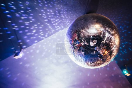 Photo for Shiny disco ball hanging in night club, night party background - Royalty Free Image