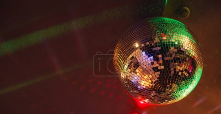 Photo for Sparkling disco ball with bright rays, nightlife background - Royalty Free Image
