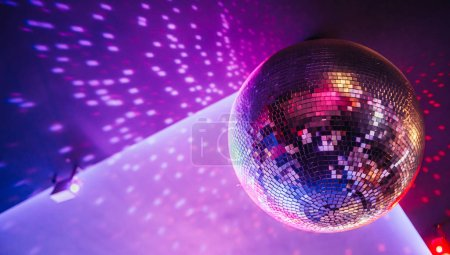 Photo for Disco ball sparkling with bright dots, night party background - Royalty Free Image