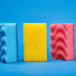 Washing sponges on blue background...