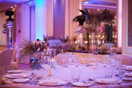 Photo for Luxury wedding reception dinner table setup. - Royalty Free Image