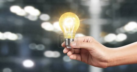 Photo for Hand of holding illuminated light bulb, innovation inspiration concept ,business idea - Royalty Free Image