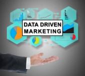 Data driven marketing concept levitating above a hand on grey background