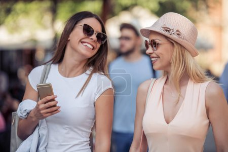 two Female friends having fun together in city