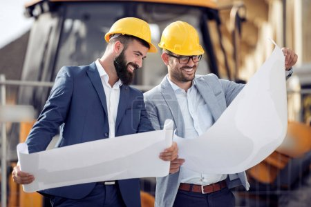 Photo for Two engineers with new project at construction site. - Royalty Free Image