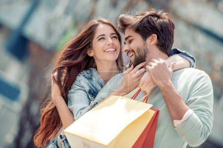 Photo for Portrait of a couple with shopping bags in the city.People,sale,love and happiness concept. - Royalty Free Image