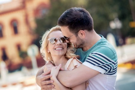 Photo for Young couple hugging and enjoying the city in daylight - Royalty Free Image