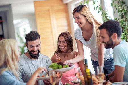 Photo for Friends meeting.Group of happy people have friendly conversation, say cheers, laughing at party at home. - Royalty Free Image