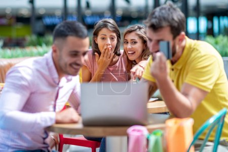 Photo for Group of young friends having fun in cafe after shopping. - Royalty Free Image