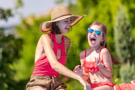 Photo for Family on summer holiday.Mother and daughter eating watermelon and enjoying on vacation. - Royalty Free Image