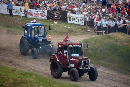 Photo for Tractor mud racing on off road terrain. Races on a cross-country terrain on BIZON Truck Show. ROSTOV-ON-DON, RUSSIA - 20.05.2018 - Royalty Free Image